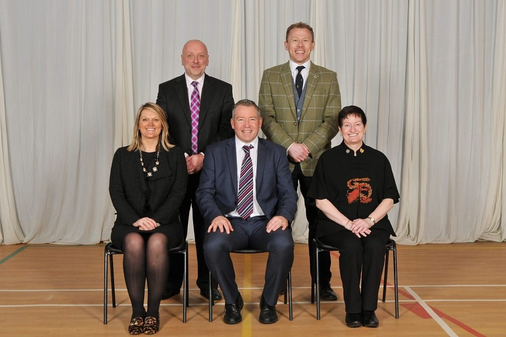 Senior Leadership Team. Left to right. Back row: Mr Nigel Cunningham, School Business Manager, Mr Steve Adams, Deputy Head (Pastoral & Guidance). Front row: Mrs Janette Scott-Laing, Deputy Head (Academic), Mr Donald J Shaw (Head), Miss Carole Phipps, Deputy Head (Pupil Support)